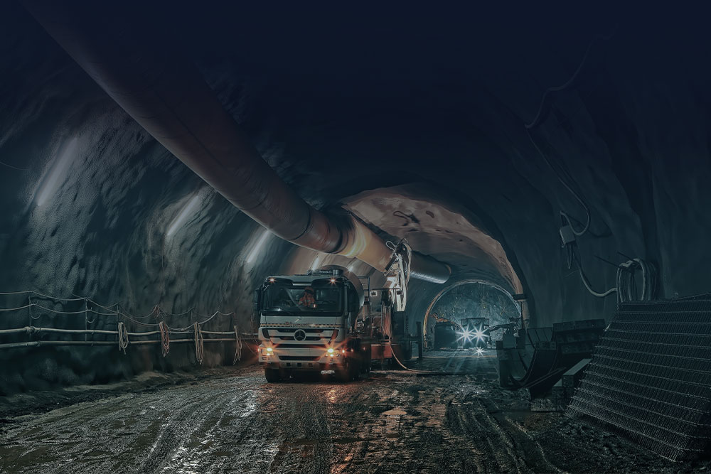 cement truck in a tunnel under a big pipe