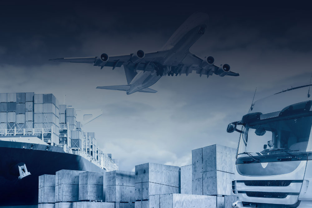 aeroplane flying over a cargo ship and a truck